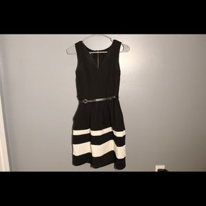 Formal black and white dress with belt and pockets